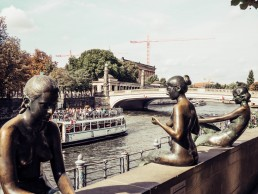Statues by the side of a river
