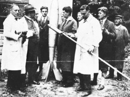 a group of young scientists stand around looking at rockets